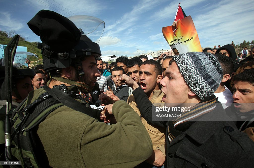 Israeli soldiers try to break up Palestinian protestors as they demonstrate against the closer of the main southwest entrance of the West Bank city of Hebron, which is situated near the Jewish settlement of Beit Hagai, in the occupied West Bank, on February 15, 2013.