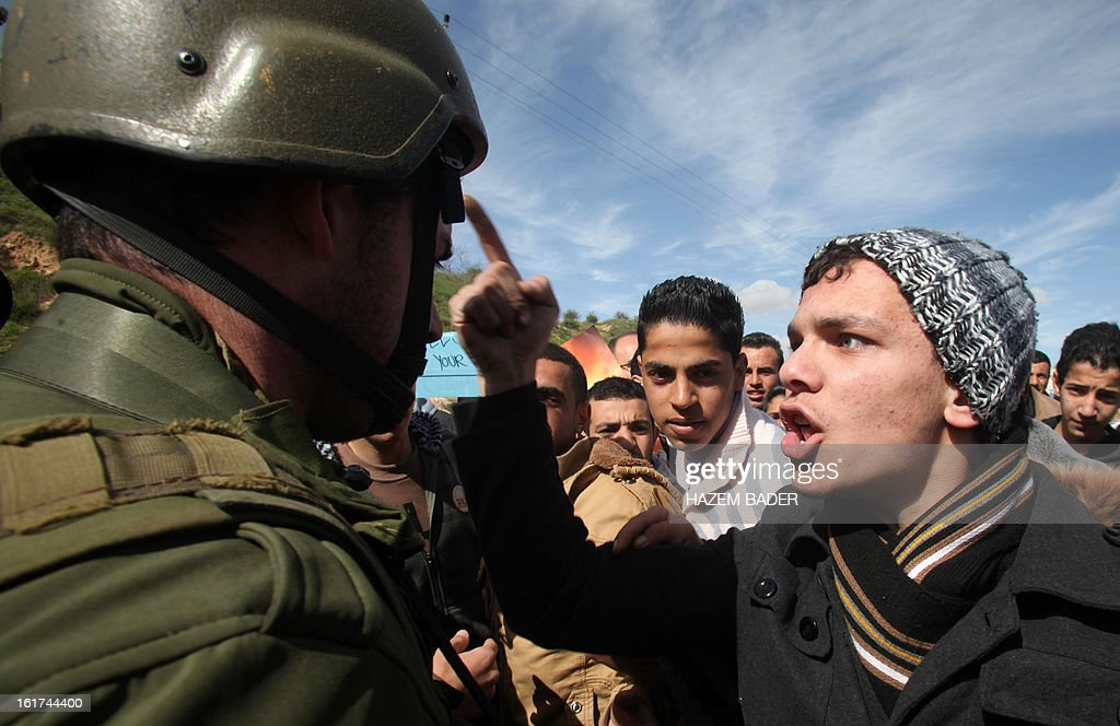 Israeli soldiers try to evacuate Palestinian protestors as they demonstrate against the closer of the main southwest entrance of the West Bank city of Hebron, which is situated near the Jewish settlement of Beit Hagai, in the occupied West Bank, on February 15, 2013.