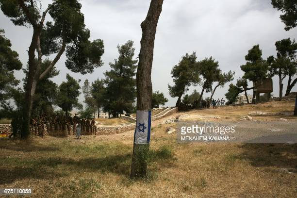 Israeli soldiers visit the memorial site of Ammunition Hill in east Jerusalem on April 30 a few hours ahead of the start of Remembrance Day...
