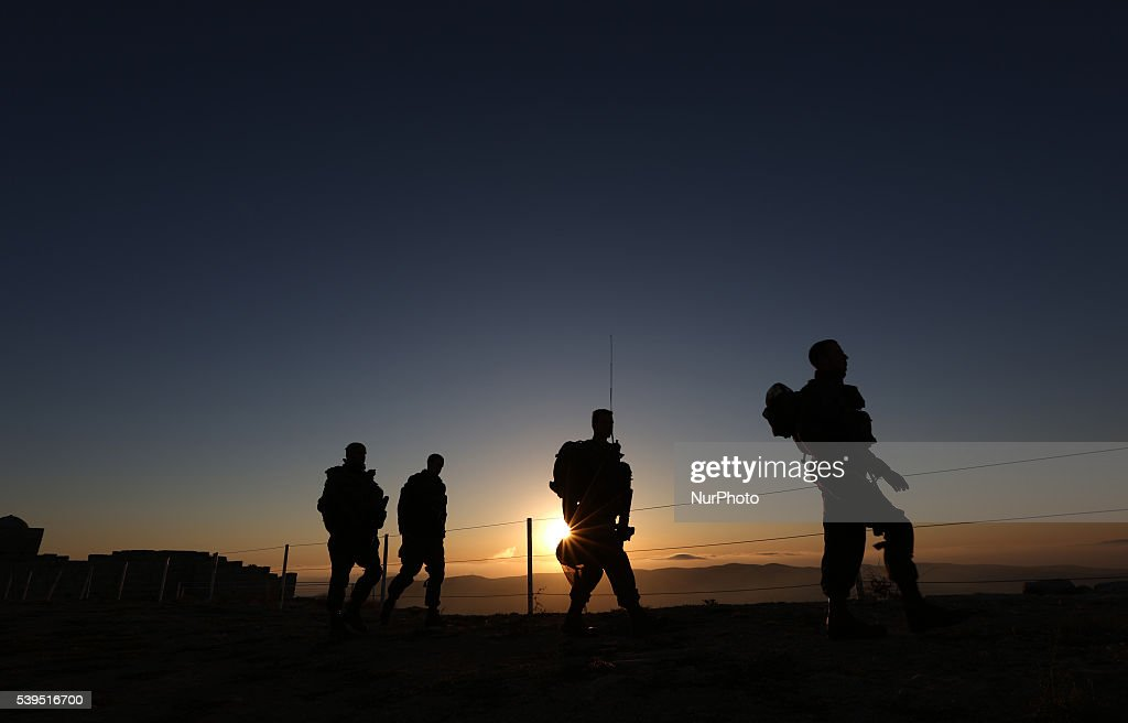 Israeli soldiers wandering atop Mount Gerizim after sunrise during Samaritan community pray above the city of Nablus West Bank 12 June 2016