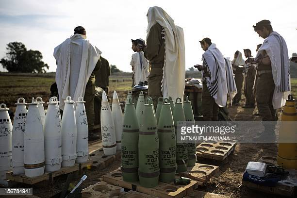Israeli soldiers wearing 'Tallit' and 'Tefilin' perform morning prayers at an artillery battery deployment near the IsraelGaza Strip border on...