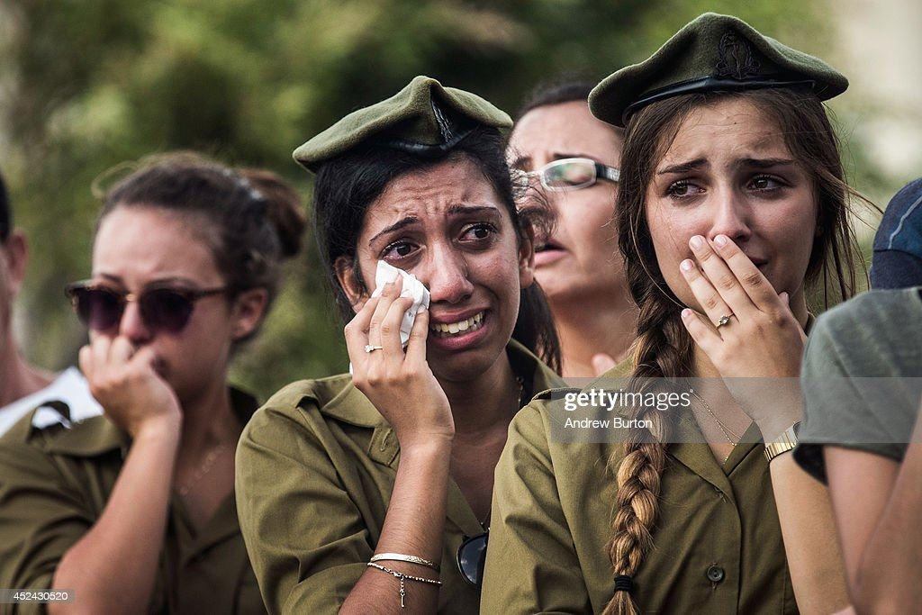 Israeli soldiers weep at the grave of Israeli Sergeant Adar Barsano during his funeral on July 20, 2014 in Nahariya, Israel. Sergeant Barsano was killed along with another IDF soldier on the twelfth day of operation 'Protective Edge,' when Hamas militants infiltrated Israel from a tunnel dug from Gaza and engaged Israeli soldiers.