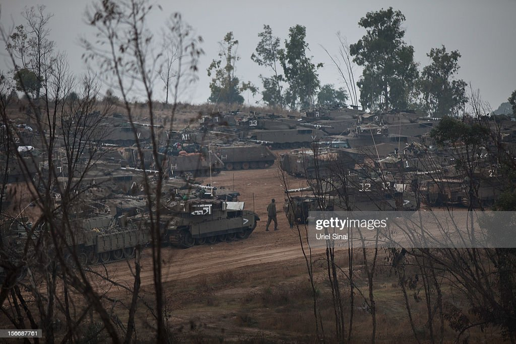 Israeli tanks are lined up in a deployment area on November 19, 2012 on Israel's border with the Gaza Strip. The death toll has risen to at least 85 killed in the air strikes, according to hospital officials, on day six since the launch of operation 'Pillar of Defence.'