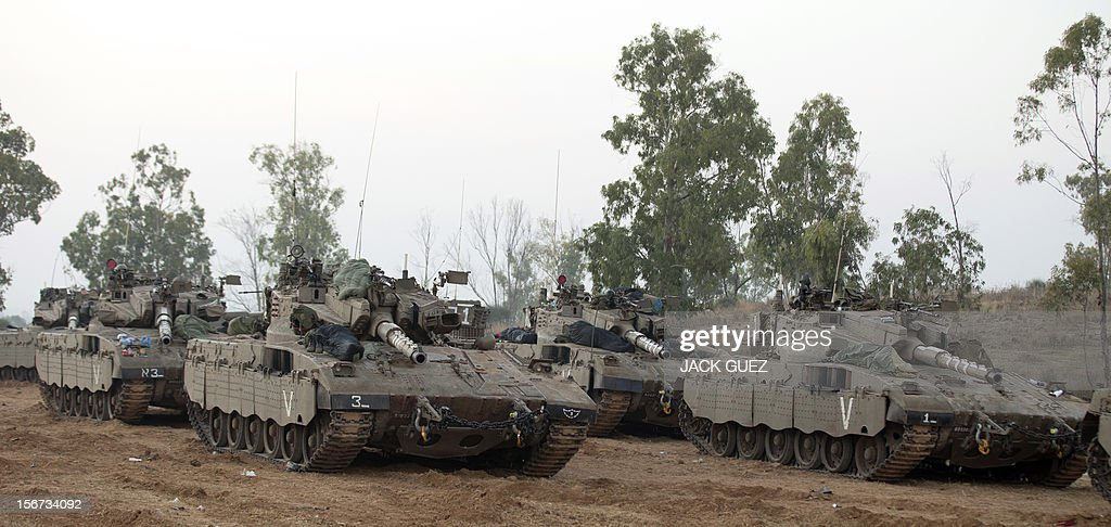 Israeli tanks are stationed at an Israeli army deployment area near the Israel-Gaza Strip border as they prepare for a potential ground operation in the Palestinian coastal enclave on November 20, 2012. Senior Israeli ministers decided overnight to hold off from launching a ground invasion of the Gaza Strip to give Egyptian-led truce efforts a chance to work, a senior Israeli official said. AFP PHOTO / JACK GUEZ