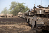Israeli tanks line up after soldiers return from Gaza on August 3 2014 near the border with Gaza Israel As Operation Protective Edge enters its 27th...