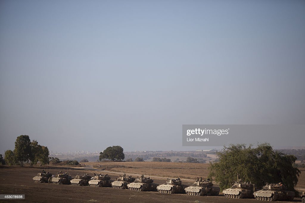 Israeli tanks park in a deployment area on August 02, 2014 on Israel's border with the Gaza Strip.The Israeli military on Friday cited indications that the officer, Second Lt. Hadar Goldin, 23, was taken captive in Rafah, a city in the Gaza Strip's south. Two other soldiers were killed in the attack, raising the number of Israeli military fatalities to 63. The announcement came not long after a 72-hour humanitarian cease-fire agreed upon by Israel and Hamas collapsed within two hours of being launched.