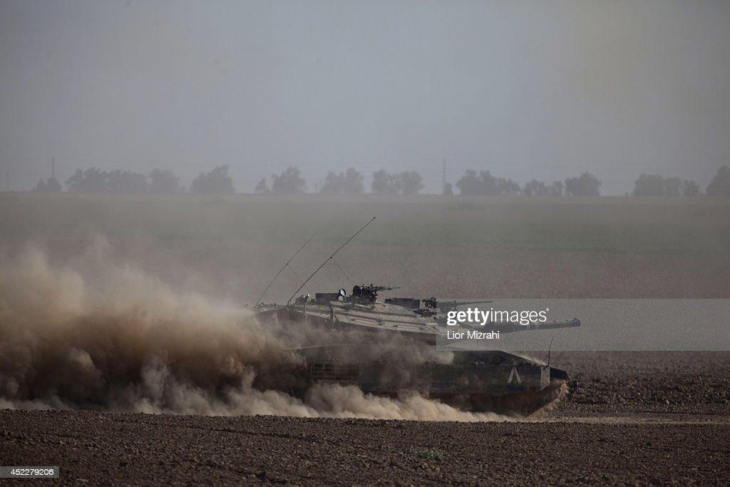 Israeli tanks seen moving along the border with Gaza on July 17 2014 on Israel's border with the Gaza Strip As the Israeli operation 'Protective...