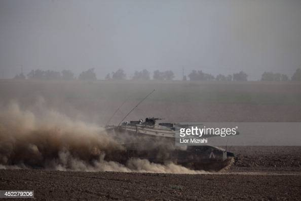 Israeli tanks seen moving along the border with Gaza on July 17 2014 on Israel's border with the Gaza Strip As the Israeli operation 'Protective...