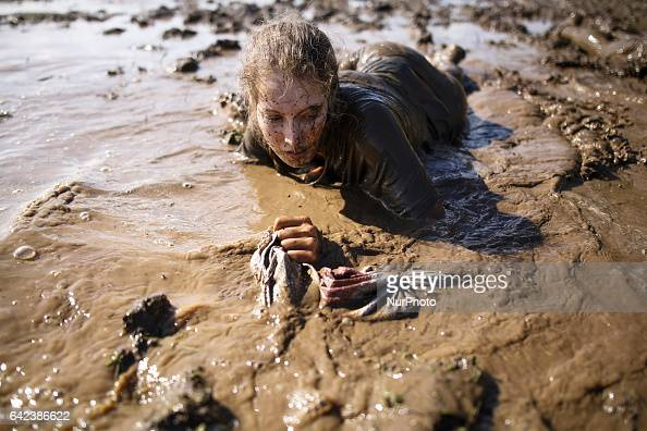 Israeli teenagers crawl with heavy sandbags through mud as they take part in an annual combat fitness training competition in preparation for their...