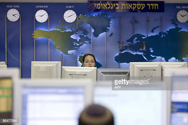 Israeli traders look at a computer screen at the foreign currency trading room of the Israeli First International Bank in Tel Aviv on October 13 2008...