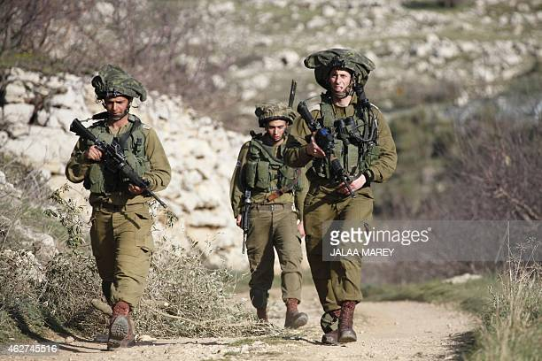 Israeli troops patrol the Israelioccupied sector of the Golan Heights on the border with Syria after a soldier was moderately injured by a landmine...