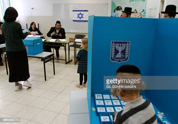 Israeli ultraorthodox Jewish residents arrive to cast their ballot at a polling station in Bnei Brak near the city of Tel Aviv on March 17 2015...