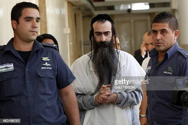 Israeli ultraorthodox Yishai Shlissel suspected of stabbing six Gay Pride marchers the previous day is brought handcuffed to the Jerusalem...