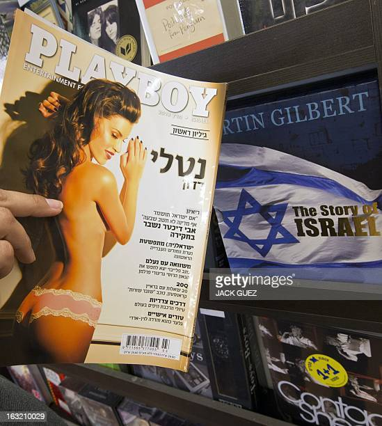 A Israeli woman reads the first Hebrew edition of the iconic men's magazine Playboy in Israel following the magazines debut in the Holy Land at a...