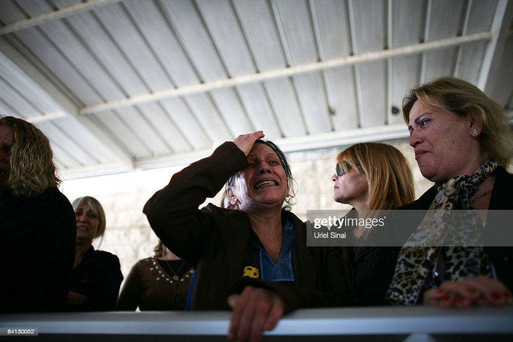 Israeli women mourn during the funeral of Beber Vaknin who was killed by a Palestinian rocket on December 28 2008 in southern city of Netivot Israel...