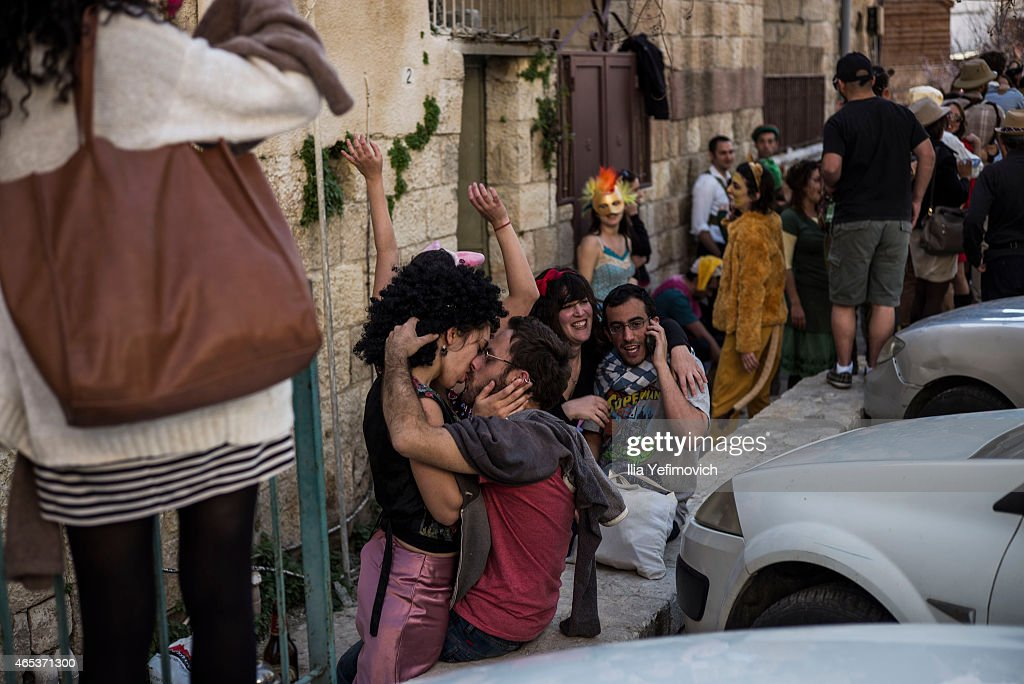 Israeli youth celebrate during the festival of Purim during a street party on March 6 2015 in Jerusalem Israel The carnivallike Purim holiday is...
