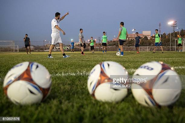 Israeli youth players from the Aroni Ariel football club attend a training session at their stadium in the Israeli West Bank settlement of Ariel on...