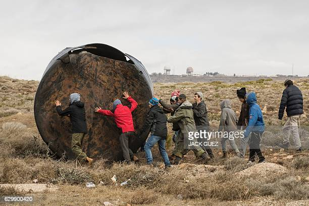 Israeli youth settlers block the entrance of the settlement outpost of Amona on December 15 which was established in 1997 in the Israelioccupied West...