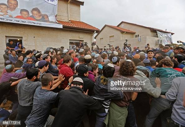 Israeli youths supporters of settlements scuffle with Israeli police forces in the settlement of Ofra in the occupied West Bank during an operation...
