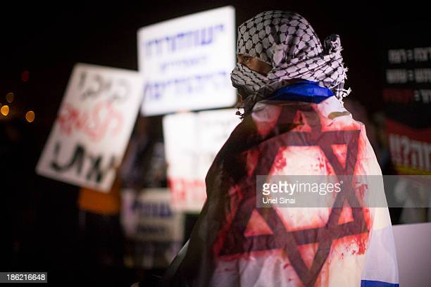 Israeli youths wear keffiyehs traditional Palestinian scarfs as right wing Israelis demonstrate against the release of 26 Palestinian prisoners on...