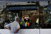 Israeli Zaka volunteers and security forces inspect the scene following a Palestinian shooting attack on a bus in the east Jerusalem Jewish...