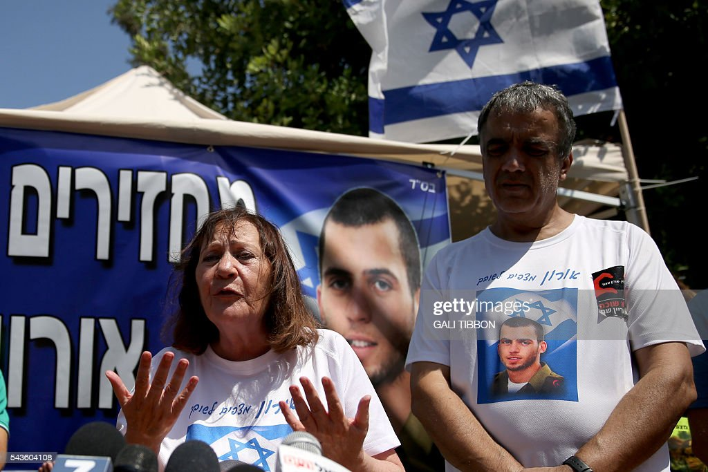 Israeli Zehava Shaul, the mother of slain Israeli soldier Oron Shaul, who was killed in Gaza during the summer of 2014's 50-day military campaign against Hamas and body's has not been recovered, speaks during a press conference on June 29, 2016 next to her husband Herzel (R) at their protest tent outside the prime minister's residence in Jerusalem. The Israeli army believes they were killed and Hamas has yet to provide reliable evidence to counter that. TIBBON