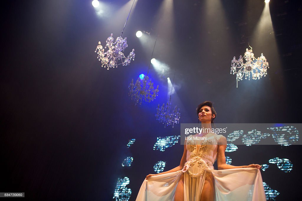 Israeli-Arab contestant Taalin Abu Hana (C), the winner of the first Miss Trans Israel beauty pageant, walks on stage on May 27, 2016 in Tel Aviv, Israel. Twelve Israeli transgender finalists took part in the event. The event marks the beginning of the 2016 Pride events.