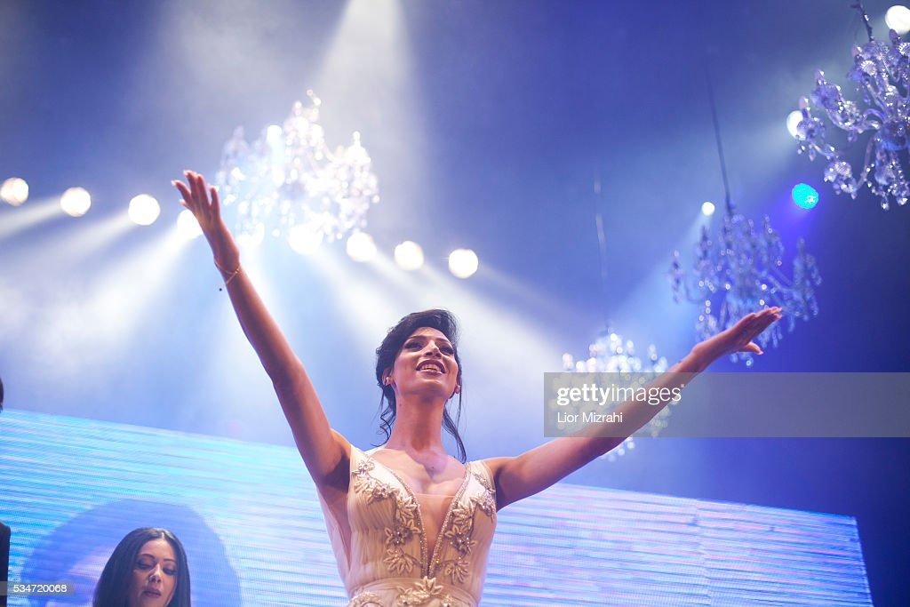 Israeli-Arab contestant Taalin Abu Hana , the winner of the first Miss Trans Israel beauty pageant, waves on May 27, 2016 in Tel Aviv, Israel. Twelve Israeli transgender finalists took part in the event. The event marks the beginning of the 2016 Pride events.