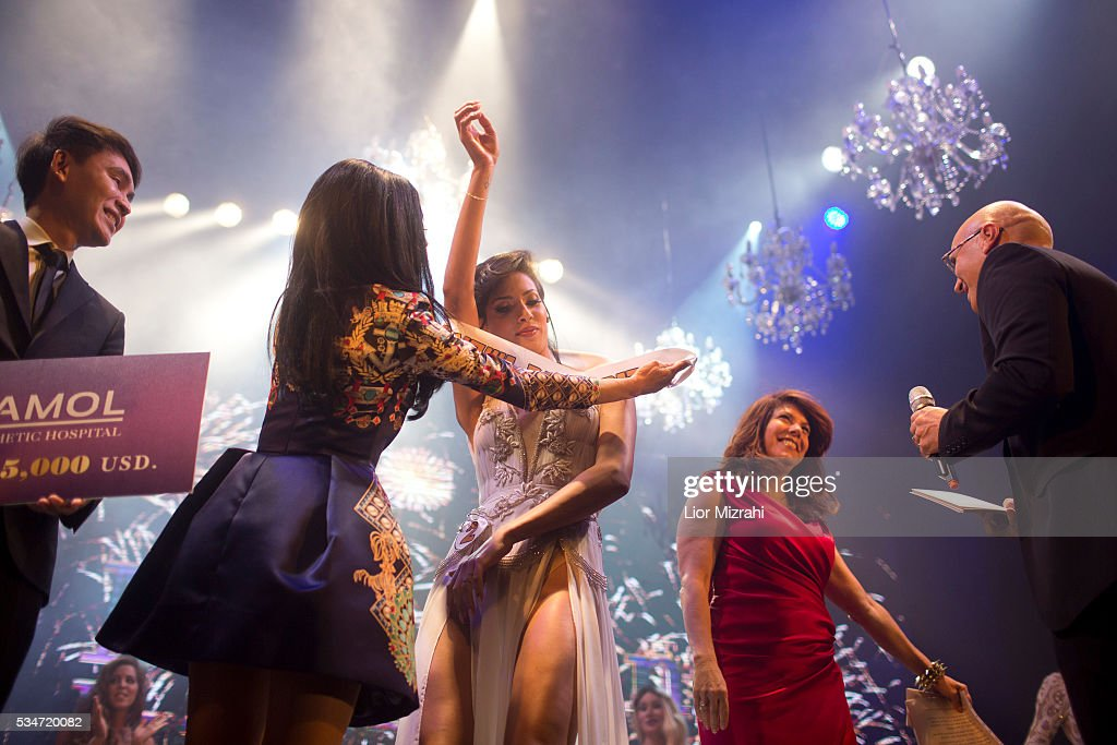 Israeli-Arab contestant Taalin Abu Hana (C), the winner of the first Miss Trans Israel beauty pageant, is seen on May 27, 2016 in Tel Aviv, Israel. Twelve Israeli transgender finalists took part in the event. The event marks the beginning of the 2016 Pride events.