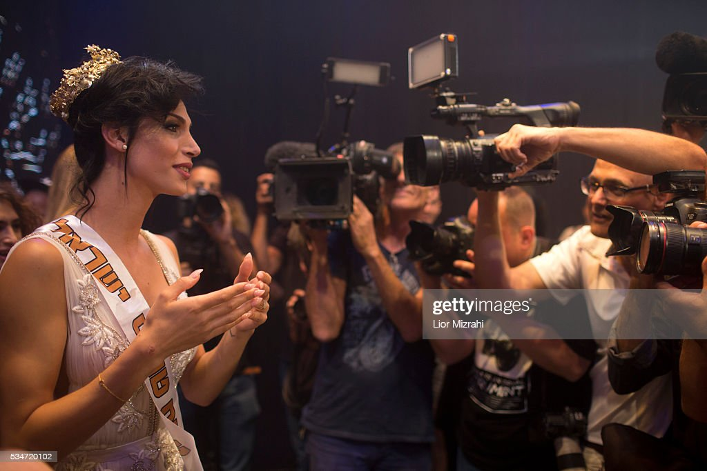 Israeli-Arab contestant Taalin Abu Hana (R), the winner of the first Miss Trans Israel beauty pageant, speaks to the media on May 27, 2016 in Tel Aviv, Israel. Twelve Israeli transgender finalists took part in the event. The event marks the beginning of the 2016 Pride events.