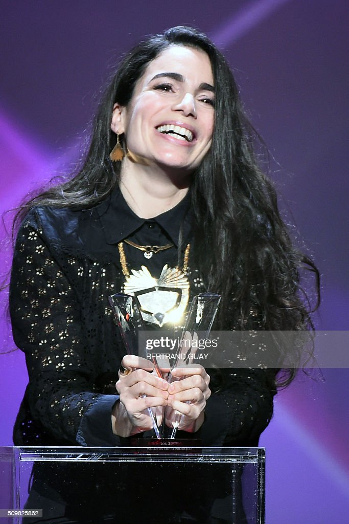 Israeli-French singer-songwriter Yael Naim smiles as she received the female artist award during the 31st Victoires de la Musique, the annual French music awards ceremony, on February 12, 2016 at the Zenith concert hall in Paris. AFP PHOTO / BERTRAND GUAY / AFP / BERTRAND GUAY