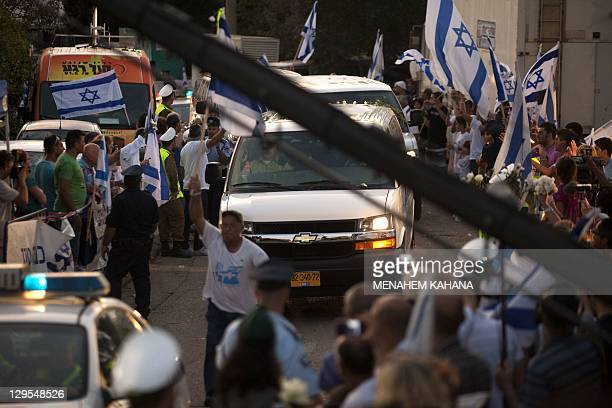 Israelis celebrate following the return of Israeli soldier Gilad Shalit at their home town of Mitzpe Hila following a landmark deal with Hamas which...