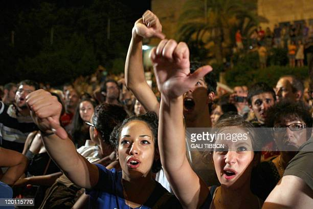 Israelis chant slogans as they march to the residency of Israel's Prime Minister Benjamin Netanyahu in Jerusalem on July 30 to protest against rising...