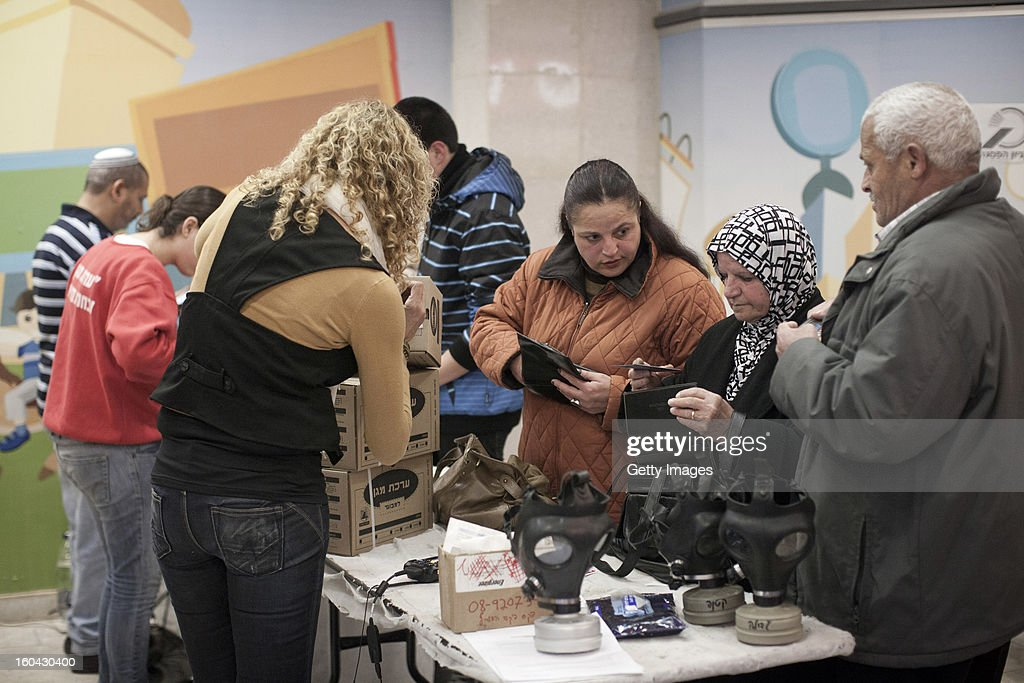 Israelis collect gas mask kits from a distribution station in a mall January 31, 2013, in Pisgat Ze'ev, East Jerusalem, Israel. Israel remains on high alert after the Israeli air force reportedly launched an airstrike January 30, on a convoy that Israeli officials said was carrying weapons from Syria to Lebanon on the Syria-Lebanon border.