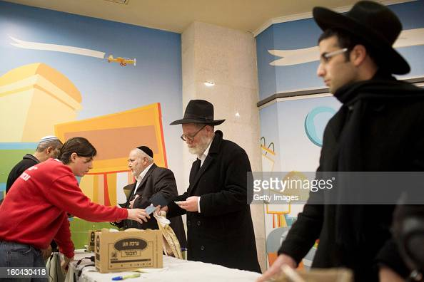 Israelis collect gas mask kits from a distribution station in a mall January 31 in Pisgat Ze'ev East Jerusalem Israel Israel remains on high alert...