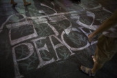 Israelis draw on the ground at the center of Jerusalem during a flash mob for peace on July 12 Israel Israel's operation 'Protective Edge' has...