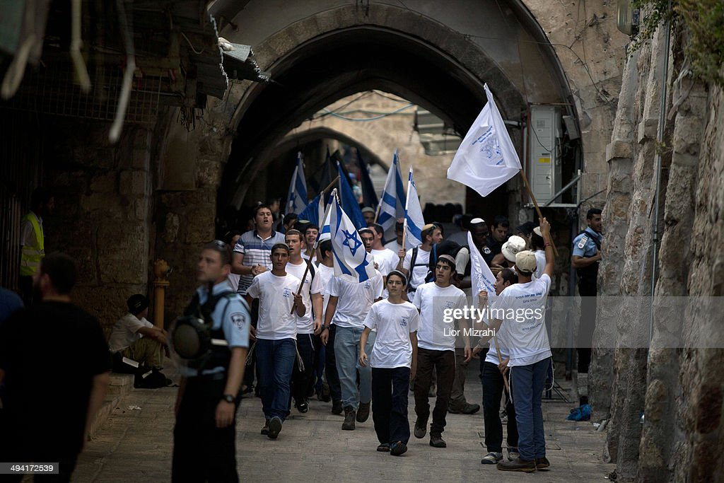 Israelis during a march marking Jerusalem Day on May 28, 2014 inside Jerusalem's old city, Israel. Israel is celebrating the anniversary of the 'unification' of Jerusalem, marking 47 years since it captured mainly Arab east Jerusalem during the 1967 Middle East war.