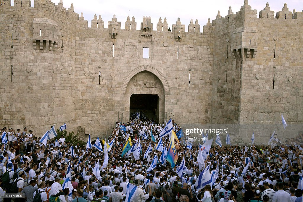 Israelis during a march marking Jerusalem Day on May 28, 2014 outside Jerusalem's old city, Israel. Israel is celebrating the anniversary of the 'unification' of Jerusalem, marking 47 years since it captured mainly Arab east Jerusalem during the 1967 Middle East war.