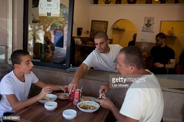 Israelis eat hummus at Abu Hassan restaurant on October 09 2013 in Jaffa a suburb of Tel Aviv Israel