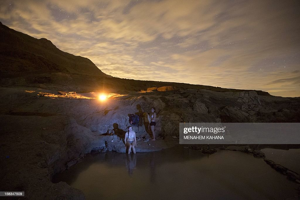 Israelis enjoy a hot water spring on the shore of the Dead Sea near the Israeli Kibbutz of Ein Gedi as they watch the sky looking for Geminid meteor streaks above Judean desert early December 14, 2012. The meteor display, known as the Geminid meteor shower because it appears to radiate from the constellation Gemini, is thought to be the result of debris cast off from an asteroid-like object called 3200 Phaethon. The shower is visible every December.