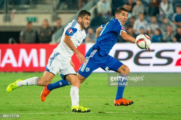 Israeli's forward Munas Dabbur vies with Cypriot's forward Nestor Mytidis during the Euro 2016 qualifying football match between Israel and Cyprus at...