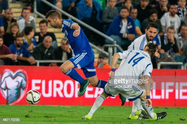 Israeli's forward Munas Dabbur vies with Cypriot's midfielder Vincent Laban during the Euro 2016 qualifying football match between Israel and Cyprus...