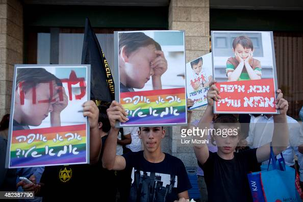 Israelis from religious organisation Lehava demonstrate against the Gay Pride Parade with signs that say 'Father where is my mother' on July 30 2015...