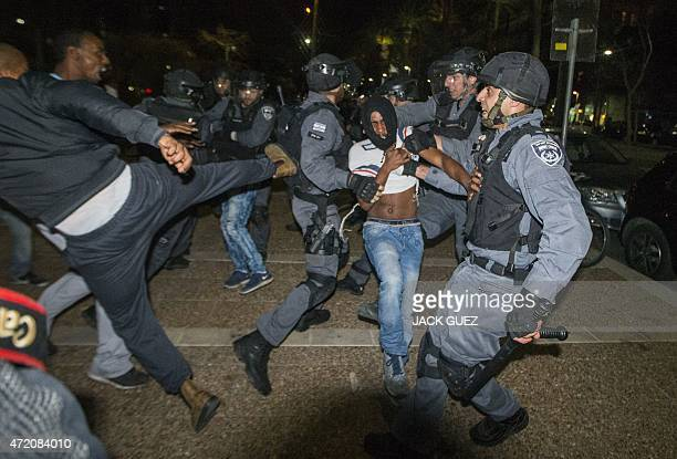 Israelis from the Ethiopian community scuffle with Israeli security forces in the coastal city of Tel Aviv on May 3 during a protest against alleged...