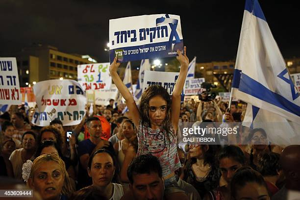 Israelis gather during a protest calling on the government and the army to end Palestinian rocket attacks from Gaza once and for all in the...