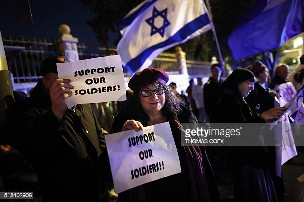 Israelis gather in front of the Prime Minister's residence in Jerusalem on March 31 to express their support to an Israeli soldier caught on video...
