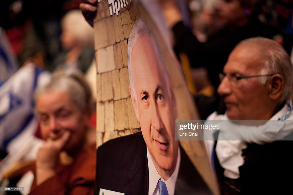 Israelis hold a poster of Prime Minister Benjamin Netanyahu during the launch the Likud-Beitenu election campaign on December 25, 2012 in Jerusalem, Israel. Netanyahu has recently seen his party lose ground to the right-wing Habayit Hayehudi-National Union party.