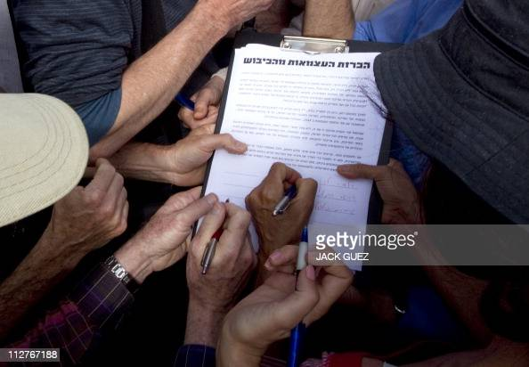 Israelis leftwing protestors sign a petition to announce their support for the declaration of a Palestinian state in boundaries based on 1967 borders...