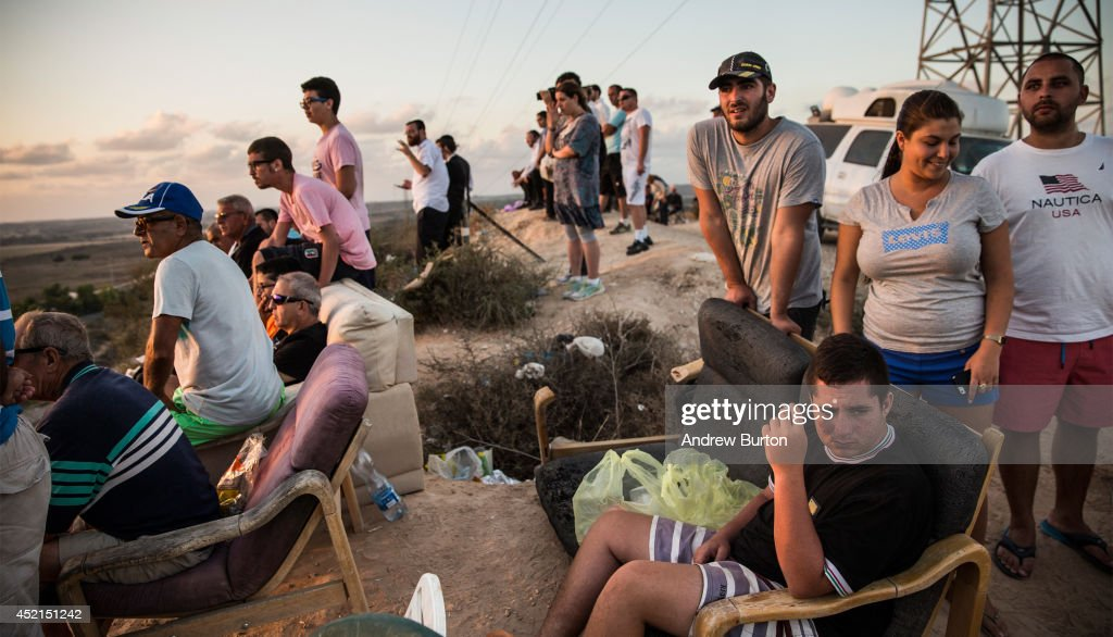 Israelis look for outgoing rocket fire from Gaza and wait for Israeli airstrikes from a hill overlooking the Gaza Strip on July 14 2014 in Sderot...