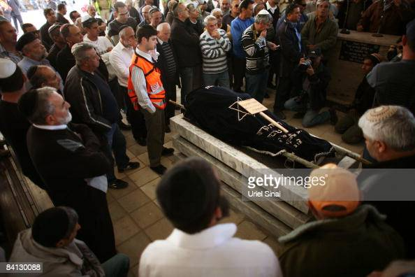 Israelis mourn during the funeral of Beber Vaknin who was killed by a Palestinian rocket December 28 2008 in the southern city of Netivot Israel...